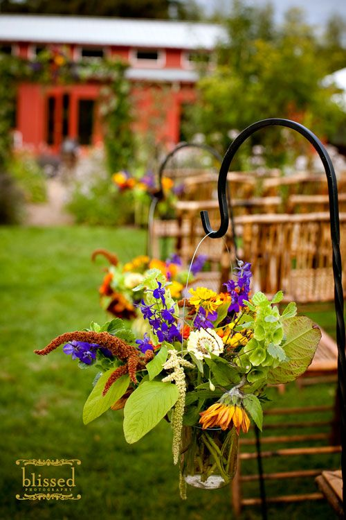 Shepards hooks with maison jar flowers down the isle