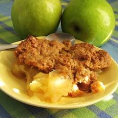 Apple Crisp XXXV Recipe. 4 cups sliced apples. 1 teaspoon ground cinnamon. 1/2 cup water. 1 cup white sugar. 1/2 cup butter. 3/4 cup all-purpose flour.  1.Heat oven to 350 degrees F (175 degrees C). Grease an 8x8 inch baking dish. 2.Place apples in prepared dish. Sprinkle with cinnamon. Pour water over all. In a bowl, cream together sugar and butter. Blend in flour. Sprinkle mixture evenly over apples. 3. Bake 30 to 40 minutes, until apples are tender and crust is golden. Dessert.