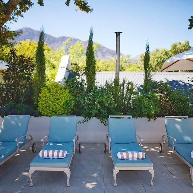 Relaxation areas command arresting vistas of the Franschhoek valley.   Take it all in. Welcomed seclusion is provided by a sunken pool, surrounded by an exclusive tanning deck.   Our roof top deck is designed to capture a small piece of this region's natural grandeur. The Last Word, beyond boutique.    ______  #travelandleisure #travelawesome #beautifulhotels #beautifuldestinations...