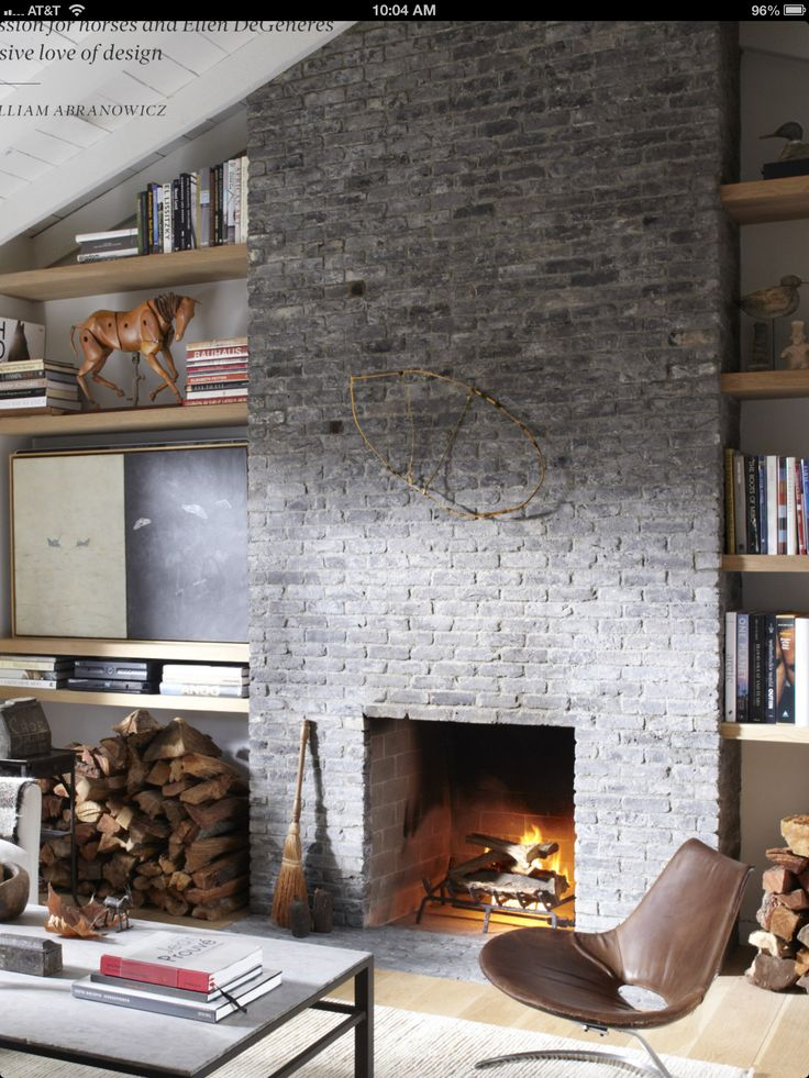 Minimalist stone - no mantle   Shelving with angle to ceiling height