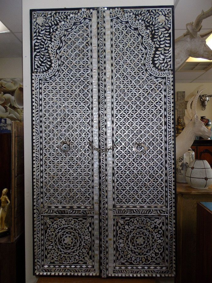 A set of handcrafted double doors.  Lovingly made from hundreds of pieces of mother of pearl.  $2,850