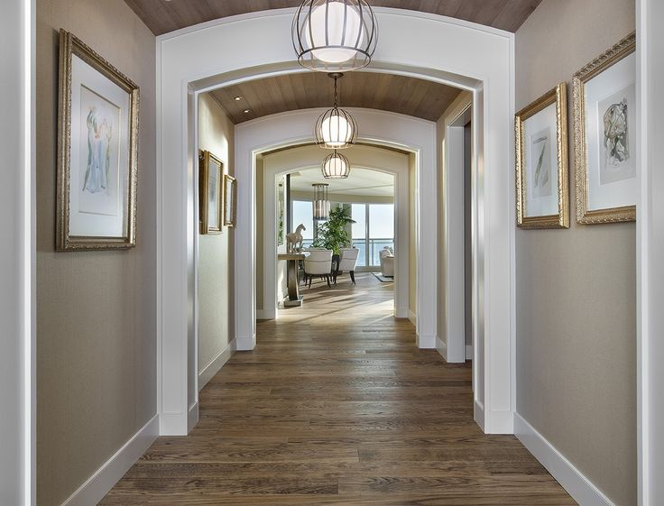 Love the width of this hall and the arched door framing throughout the hallway i