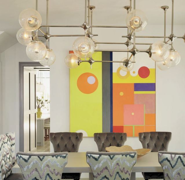 Eclectic Multi Colored Dining Area With Vintage Light Fixture