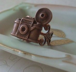 I'm not a huge fan of copper, but I love photography and this camera ring is too cute!