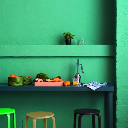 Ikea taburets painted in different colors.