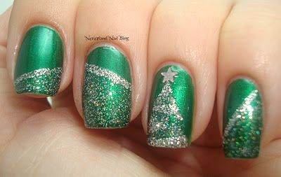 2 coats of Zoya Holly as the base color and A England Merlin with CoverGirl City Lights for the nail art. use tape to create this design