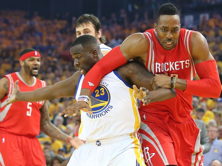 Houston Rockets center Dwight Howard (12) plays for position against Golden State Warriors forward Draymond Green (23) during the first half in game two of the Western Conference Finals of the NBA Playoffs. at Oracle Arena.  Cary Edmondson, USA TODAY Sports