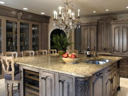 Go+natural+with+marble,+granite+and+other+long-lasting+materials.+Granite+tends+to+be+the+most+coveted+because+of+its+captivating+combination+of+texture+and+durability+along+with+its+ease+of+use:+Put+a+hot+pot+directly+on+the+surface,+roll+out+dough+and+even+cut+on+it+without+a+scratch.+Kitchen+design+by+David+Stimmel,+www.stimmeldesign.com.