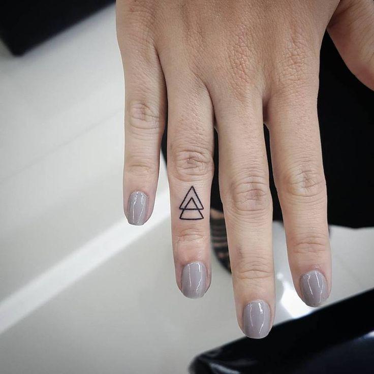 mini triangle tattoo for love finger