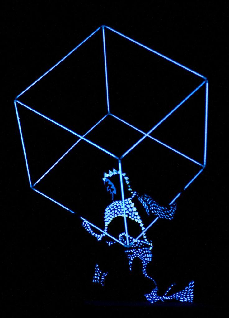 Cube juggler in black light - Anta Agni UV LIGHT Show http://antaagni.com/uv-light-show/