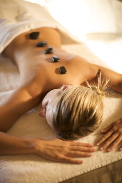 Hot Stone Therapy Massage: The heat from the stones eases muscle stiffness, relieves tension and is soothing and calming. This one of the many treatments that we offer at our spa for more information about our spa treatments click here: http://bit.ly/IwpKfM