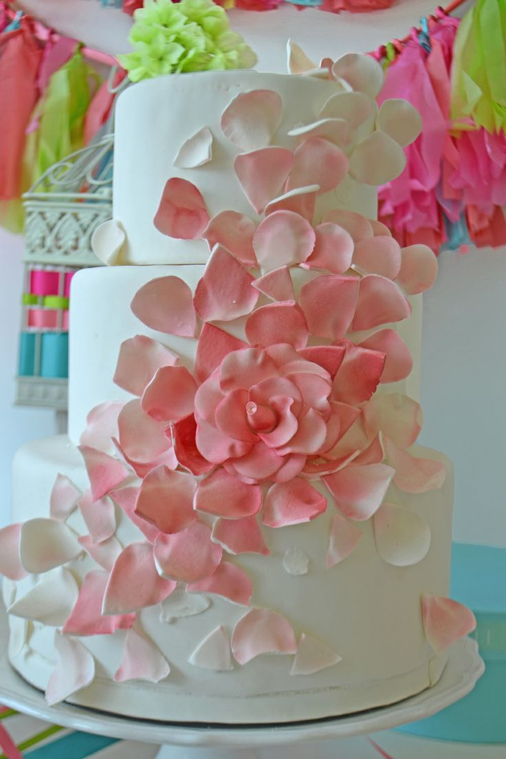 Pretty three tiered cascading rose petal cake by Bake Sale