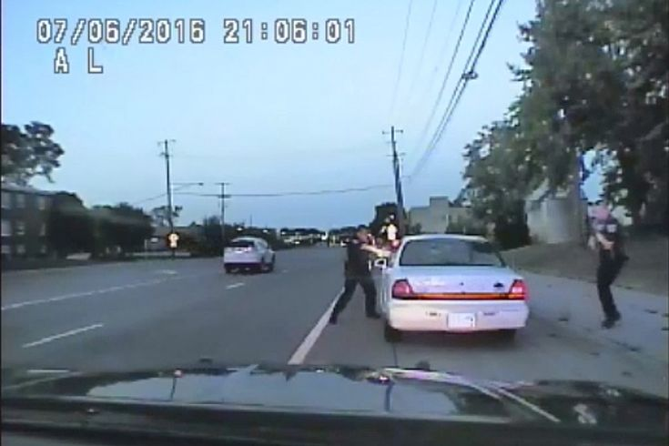 In this image made from July 6, 2016, video captured by a camera in the squad car of St. Anthony Police officer Jeronimo Yanez, the Minnesota police officer shoots at Philando Castile in the vehicle during a traffic stop in Falcon Heights, Minn. (St. Anthony Police department/AP)