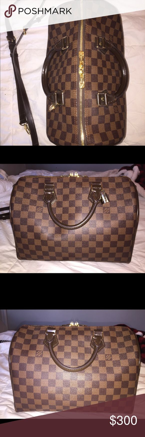 Speedy Bandouliere 30 Damier Ebene LV speedy bandouliere 30 in Damier Ebene, used a few times. Purchased on here, just don't use it enough! Gorgeous bag. Price reflects auth, listed for exposure. Open to offers :) Louis Vuitton Bags