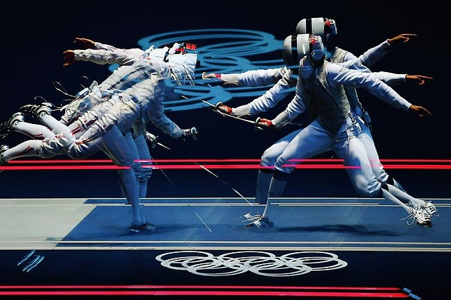 OLYMPIC-FENCING  LONDON GAMES DAY ONE ACTION:: Multiple exposures of women's fencing action at ExCel. Carolin Golubytskyi of Germany competes against Elisa Di Francisca of Italy in the individual foil. Picture: Hannah Johnston Source: Hannah Johnston / Getty Images