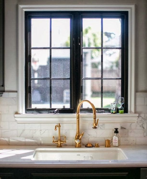 Brass Faucet And Black Framed Window