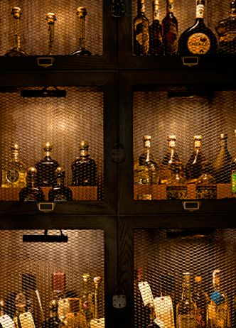 La Biblioteca | AvroKo |Guests can purchase their own bottles of rarefied agave and keep it safely stored in their own tequila locker for civilized sipping or festive shooting, should the occasion arise.