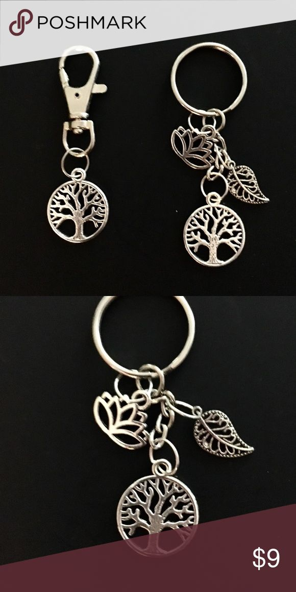 Tree of Life Bag Clip and Key Ring Set Adorable set including a Tree of Life bag Clip (or zipper pull) and a key ring with silver charms. Features a lotus flower, leaf and a matching tree. Accessories Key & Card Holders