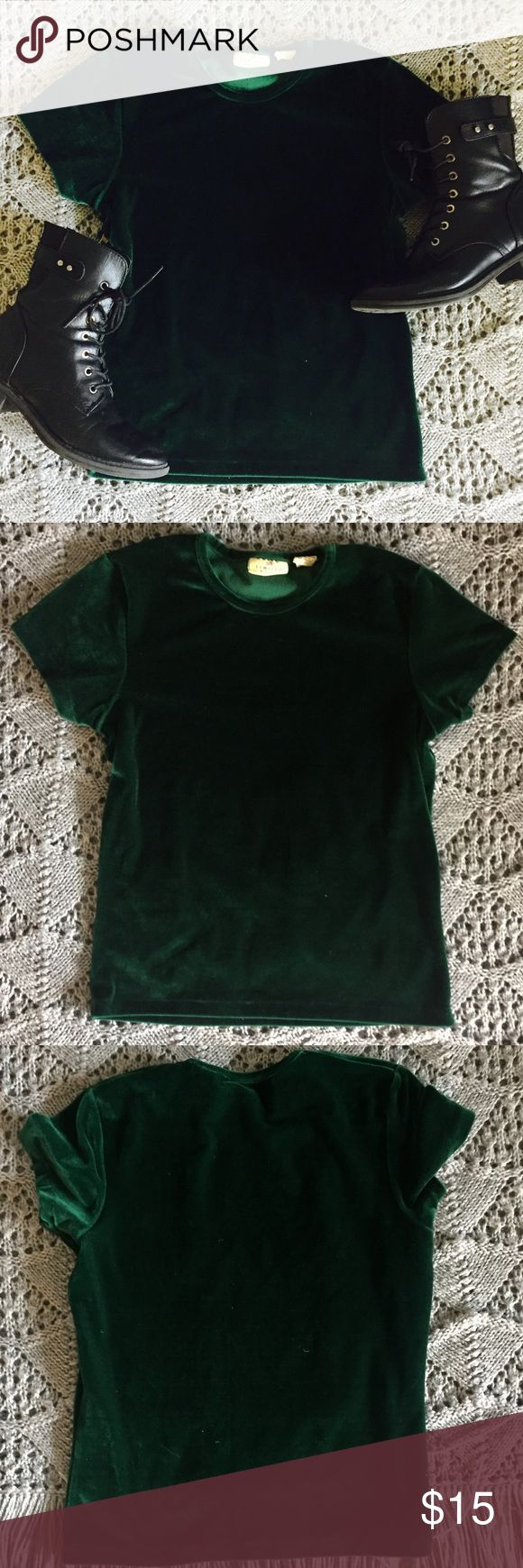 Emerald Green Velvet Tee!! Super cool emerald green velvet tee. No flaws. I think it's from the 90's but don't quote me on that! It's one of those items that is admittedly hard to capture its true essence on camera but like it's just SO COOL! Bundle for a discount! Reasonable offers always accepted! ✌️🎶😎 Limited America Tops Tees - Short Sleeve