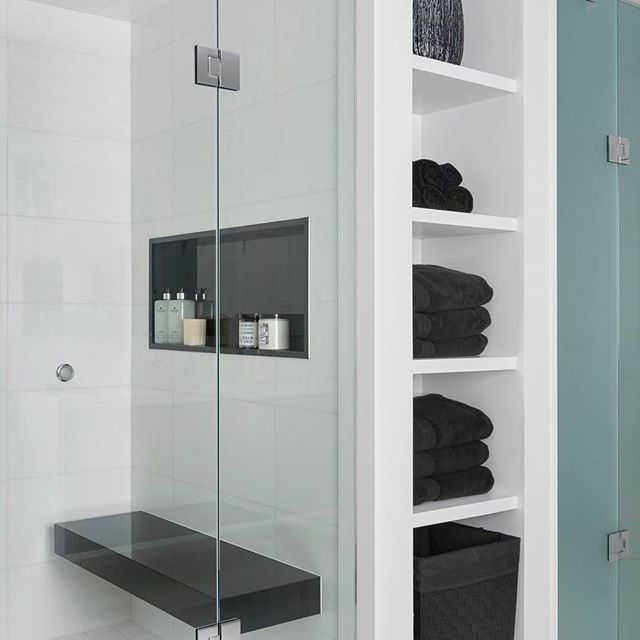 Built-in storage, tons of shower space, and a Jet Black shower bench - be still our hearts! Jodie Rosen Design certainly makes an impact with this black and white bathroom oasis.