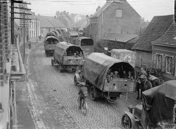 © IWM (Q 3022) 16th Auxiliary Company, Army Service Corps (A.S.C.) lorries passing through Abeele (Abele), taking troops up to the line, 15th September 1917. This is what I love about studying the...