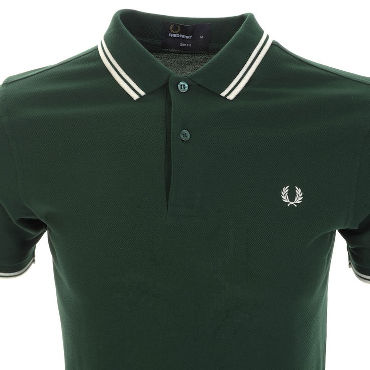 Fred Perry Twin Tipped Polo T Shirt In Ivy Green, Slim Fit. Two Fred Perry logo embossed button opening at the neck with a ribbed polo collar and ribbed cuffs on the short sleeves which have twin tipped detail in ecru white. The signature embroidered Fred Perry Laurel logo is on the left of the chest in white. 100% Cotton. Brand New Collection Of Fred Perry Polos, T Shirts And Knit Wear Live Online UK.