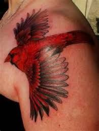 cardinal tattoo - heavy handed, but not many artistic cardinals to review.