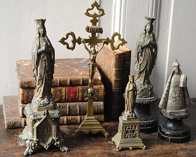 statuettes and old books