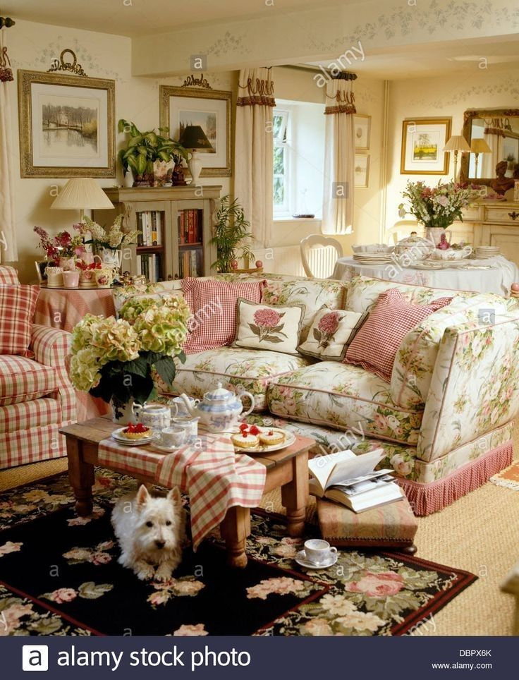 A Soft Summery Living Room Cozied Up With Books Plaid And Hydrangeas English Cottage Decor Cottage Living Rooms Cottage Style Interiors