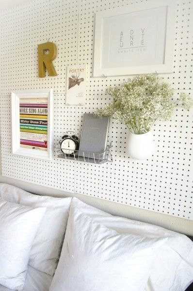 pegboard as a head board.. good idea in apartments when you can't keep putting new holes in the walls everytime you want to change things up