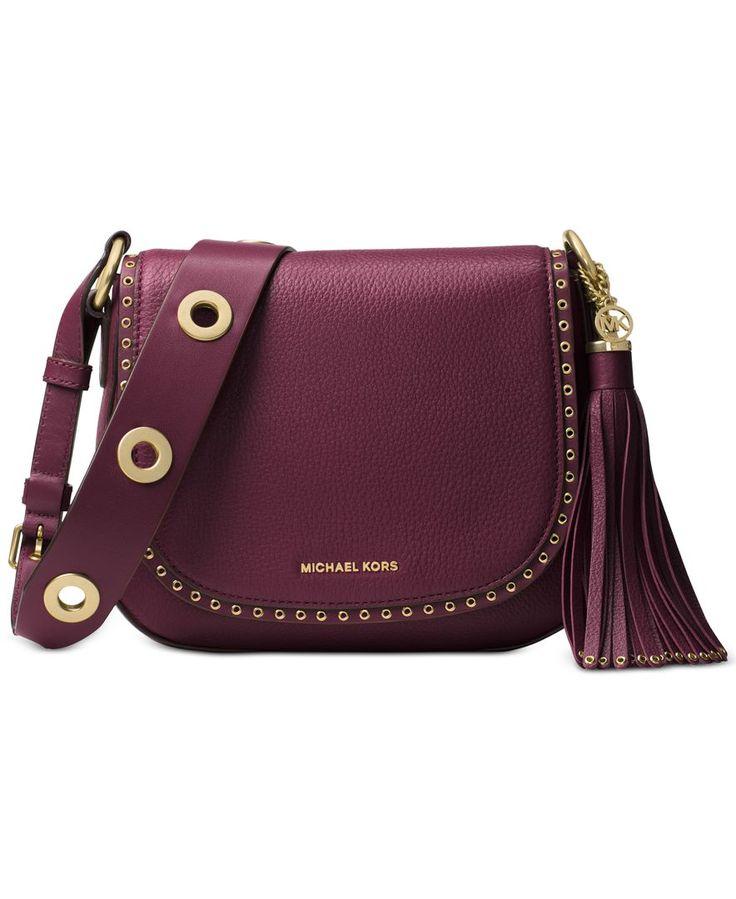 High-shine grommets punctuate Michael Michael Kors\u0027s of-the-moment saddle  bag cast
