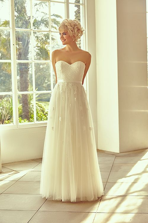 A soft A-line gown with sweetheart neckline, bespoke lace and tulle.  <strong>Size: </strong>8 – 30 <strong>Colour: </strong>Ivory <strong>Fabric:</strong> Bespoke lace, Tulle <strong>Style:</strong> Soft A-line <strong>Neckline:</strong>Sweetheart <strong>Laced or Zipped: </strong>Zipped
