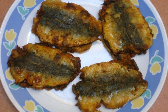 Moroccan Fried Sardines Stuffed with Chermoula,  a spicy marinade made from coriander, paprika, cumin, hot pepper.: In Morocco sardines are cooked in a variety of ways, but this chermoula-filled pan-fried version is probably prepared the most often.
