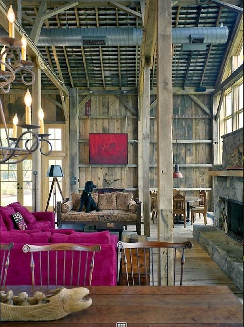 Ooh, an old barn, high ceilings, candelabras, magenta sofa...