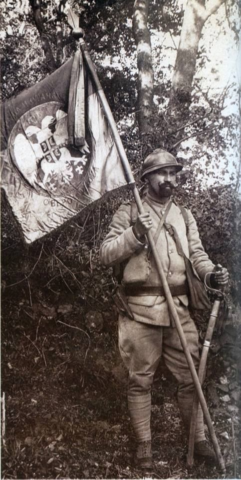 Serbian soldier with Serbian flag on the battlefield of Solun or Thessaloniki in Greece, WW1