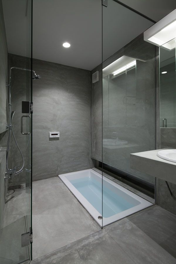 Sunken tub in shower area - maybe have some kind of teak slats that can fit over the top when showering so that you don't fall in but water can still drain?