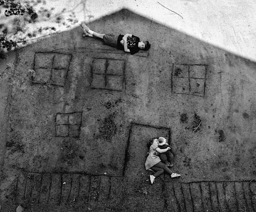 Abelardo Morell - Laura and Brady in the Shadow of Our House, 1994