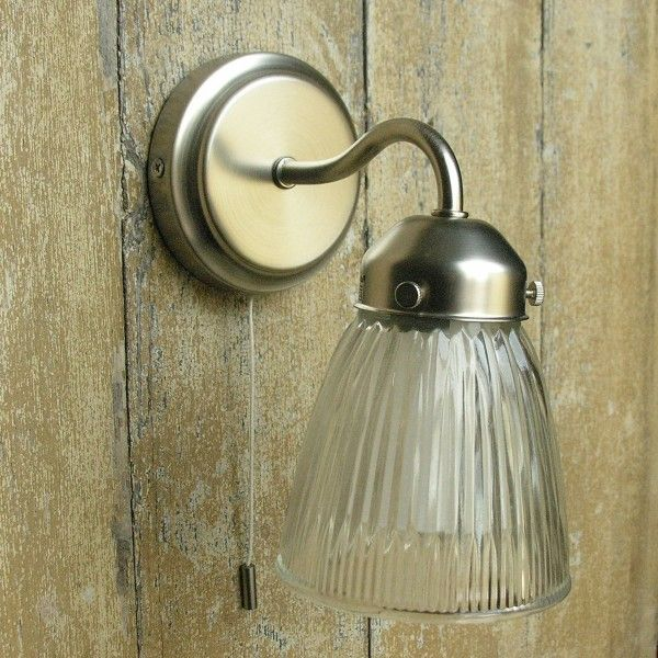 Satin finished nickel light with glass shade.