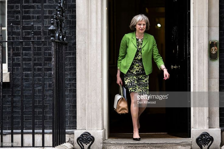 British Home Secretary Theresa May leaves after the first weekly cabinet meeting in Downing Street, on May 12, 2015 in London, England. Conservative party Prime Minister David Cameron has unveiled his new cabinet after claiming an election victory last week that gave his party an outright majority in parliament, the first time in nearly 20 years.