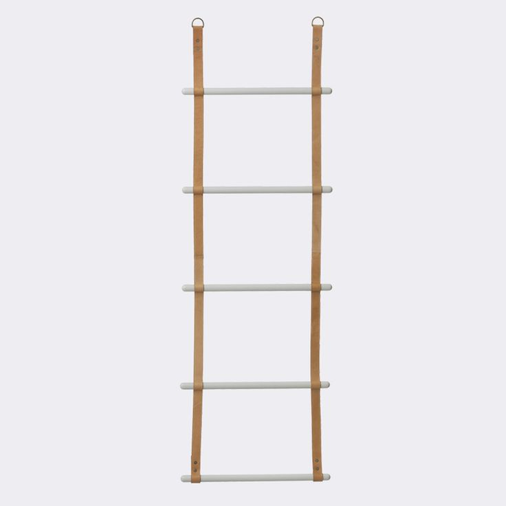 WALL HUNG LEATHER LADDERS BY DANISH INTERIORS BRAND FERM LIVING.  USE THIS LEATHER LADDER IN YOUR BEDROOM FOR CLOTHING OR BLANKETS, IN THE BATHROOM FOR TOWELS, OR EVEN IN THE HALLWAY FOR SCARFS, SWEATERS AND EVERYTHING ELSE YOU CAN THINK OF! WHILST OFFERING A GREAT STORAGE SOLUTION, IT'S AN INTERESTING DESIGN IDEA TO DISPLAY AND CURATE YOUR BELONGINGS. THE LADDER IS FOR DECORATIVE USE ONLY. NOT SUITABLE FOR CLIMBING.