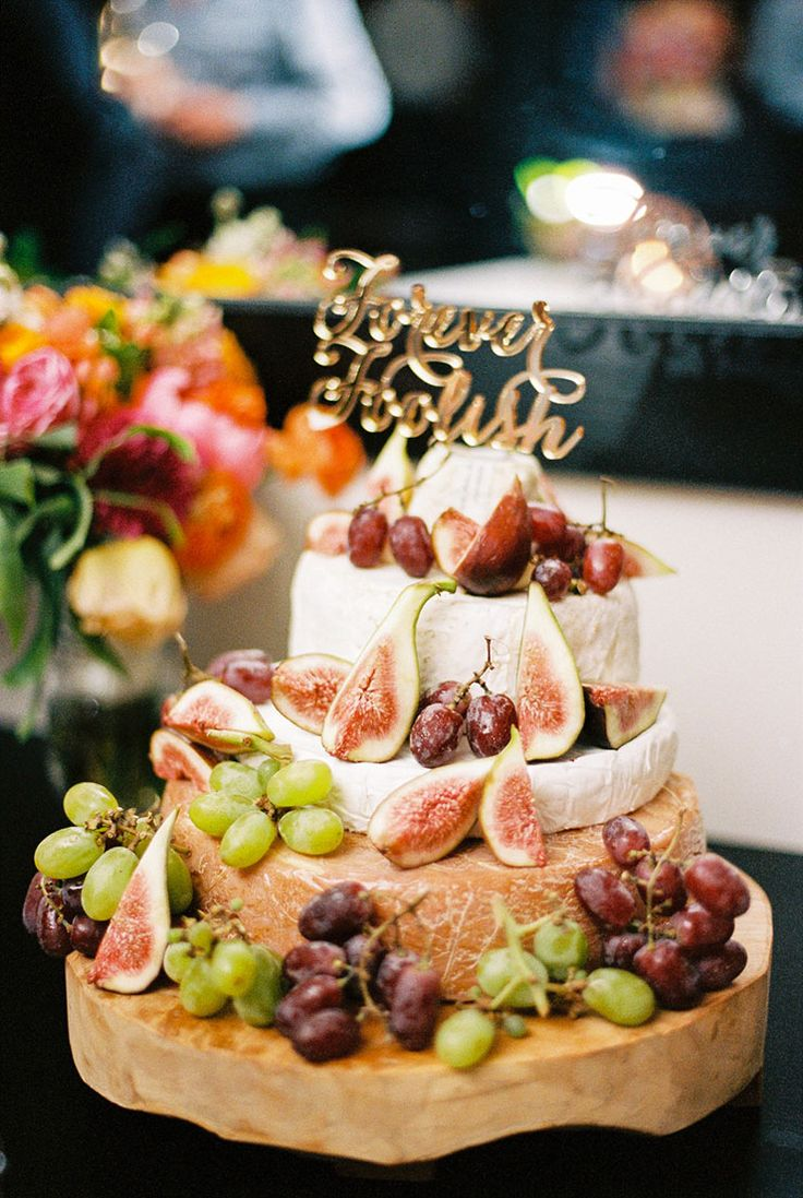 Cheese wheel cake with fresh fruit for cocktail wedding | When Elephant Met Zebra | See more: http://theweddingplaybook.com/bright-waterfront-cocktail-wedding/