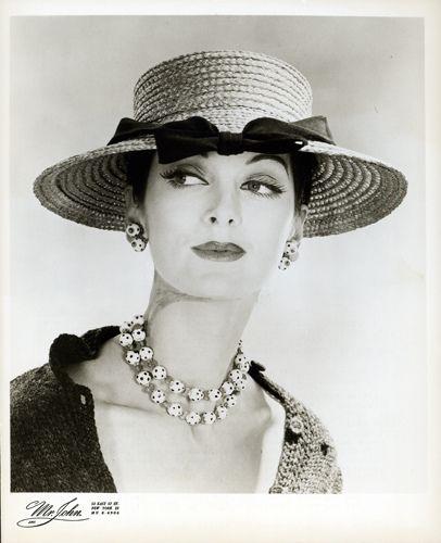 Carmen Dell Orefice in hat by Mr. John, 1955