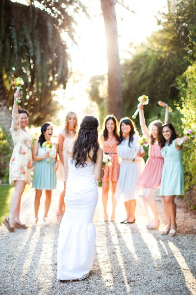 Love the different color bridesmaid dresses!   Photography by Nancy Neil / lovenancyneil.com