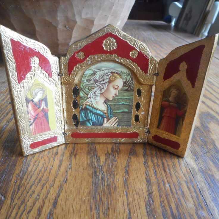 """Closed, it measures 4"""" x 3"""". Open, it measures 4"""" x 6"""". The outside is painted gold gesso and red. The center panel has a picture of the Mother Mary, with an angel on the outside panels. The colors look pale compared to in person. 