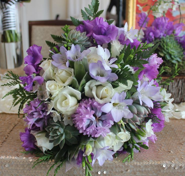 Pretty Mauve wedding Bouquet with Roses, Hyacinth, Freesia, Sweet Pea and Succulent. Created by Poppies and peas Floral Design.