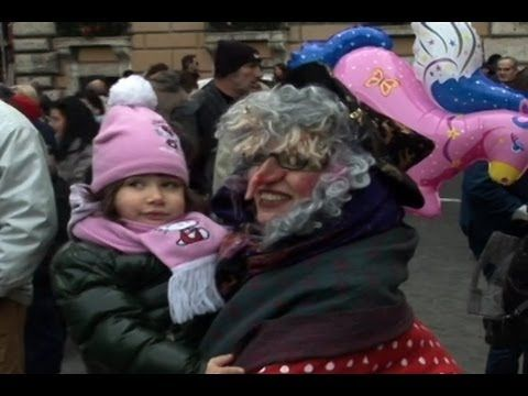 La Befana (Old Lady Who Rides A Broomstick In Italy) delivers sweets to good children and a lump of coal to bad children - For more news and videos visit ➡ http://english.ntdtv.com  Follow us on Twitter ➡ http://twitter.com/NTDTelevision  Add us on Facebook ➡ http://on.fb.me/s5KV2C    Italians celebrate the festival of La Befana, where a mystical old lady on a magic broom flies down chimneys and gives presents to children. The good ones get candy, the naughty o...