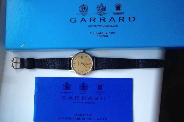 ON AUCTION TOMORROW FROM 8.30pm.......MENS 9CT SOLID GOLD GARRARD CALENDAR QUARTZ WATCH IN ORIGINAL BOX INC PAPERWORK