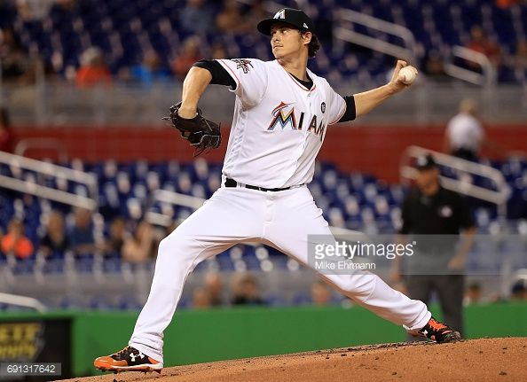 News Photo : Jeff Locke of the Miami Marlins pitches during a...