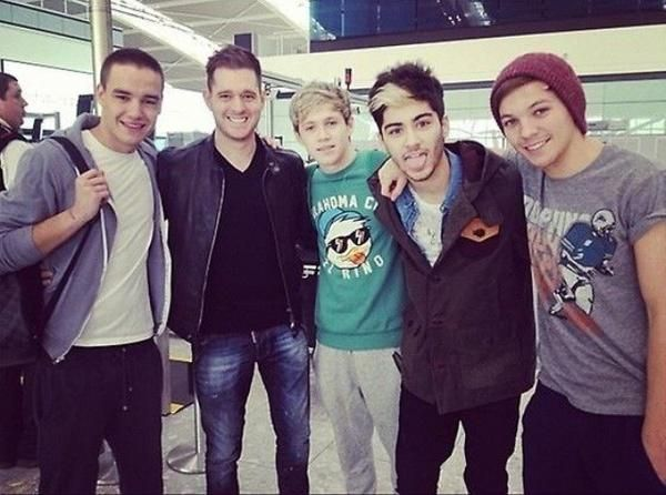 The boys minus Harry with Michael Bublé at the airport
