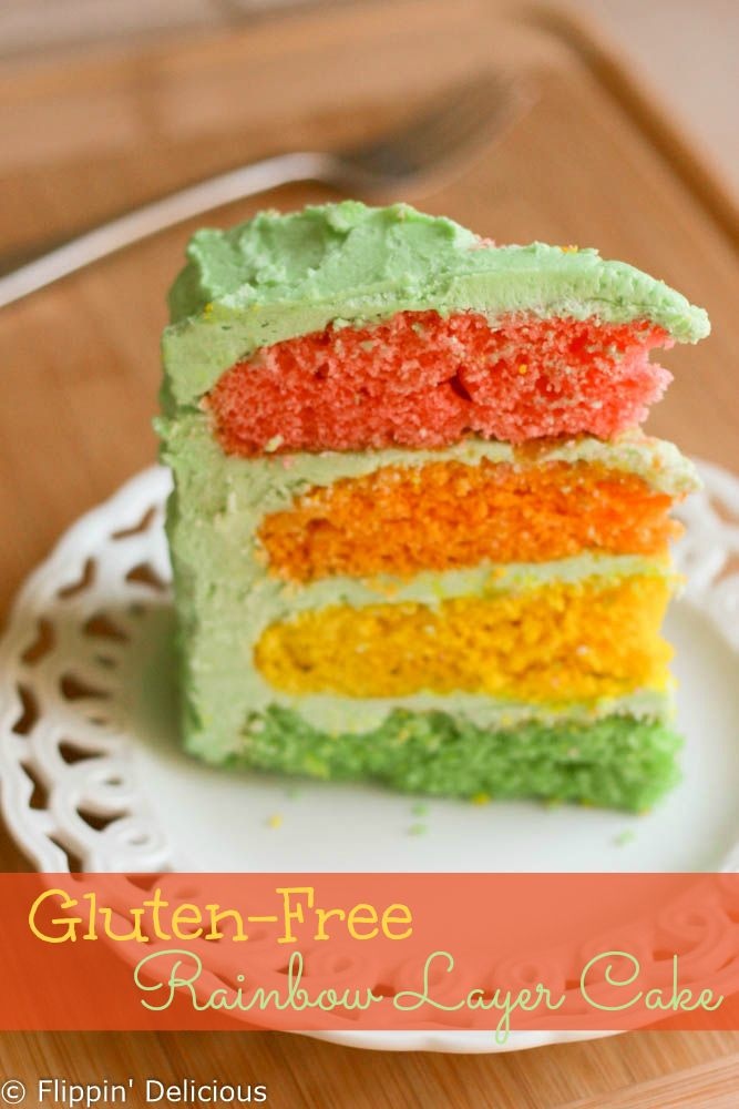 Gluten-free rainbow layer cake with buttercream frosting. Perfect for St. Patricks' Day or birthdays! Kids and grownups a like will love this gluten-free rainbow layer cake!